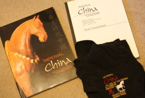 Souvenir guide, docent training manual, and work shirt from Imperial China exhibit